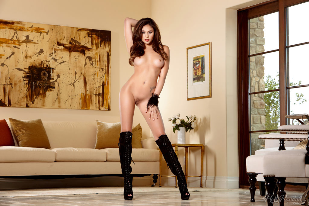 Gorgeous solo girl Ariana Marie toys her pussy in over the knee boots