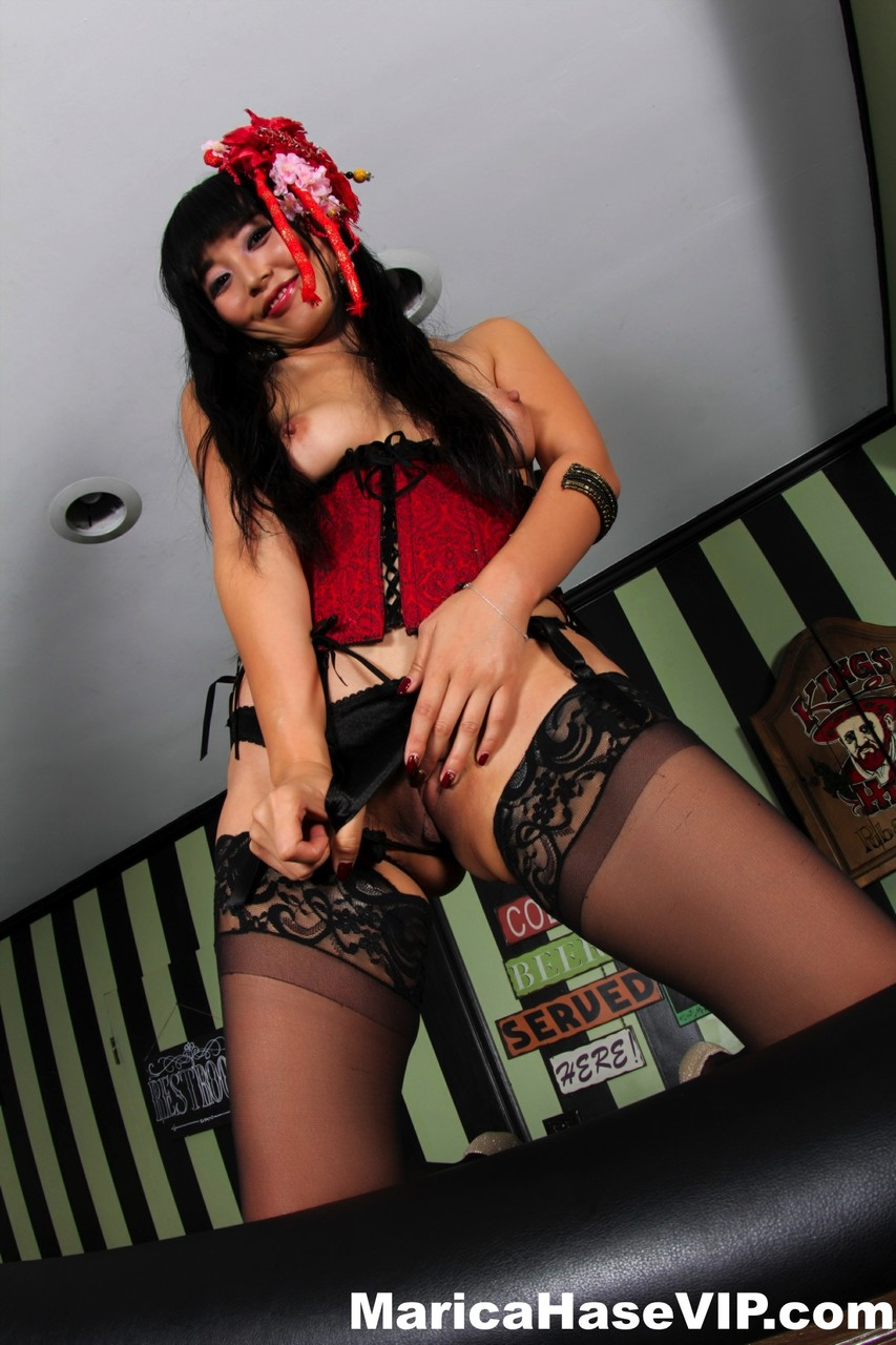Japanese beauty Marica Hase sticks out her tongue while topless in nylons