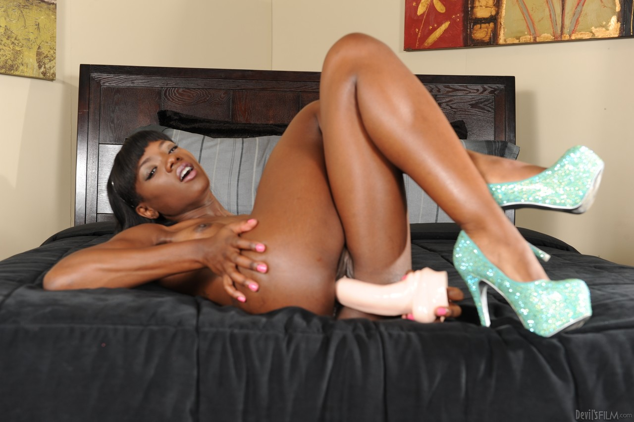 Sassy ebony Ana Foxxx gets naked to play lustily with her massive sex toys